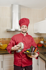 Chef in kitchen preparing food