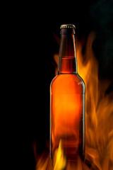 Beer bottle in fire on black
