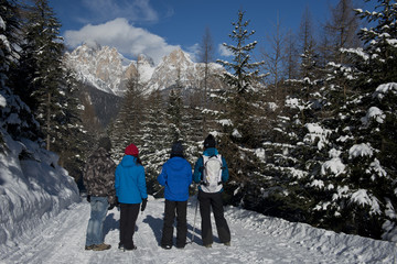 Hikers on a snowy Trail, enyoing the view