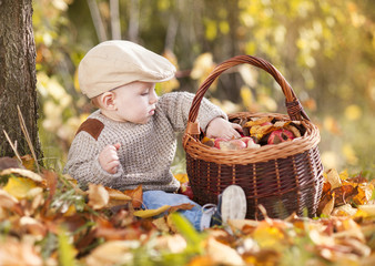 Happy child is playing in colorful autumn nature