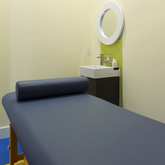 Interior design of massage room in a clinic center
