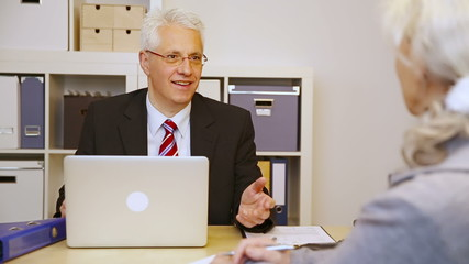 Customer talking to businessman in office