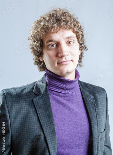 portrait of a young guy with curly hair