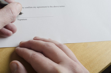 Hand Signing Legal Document
