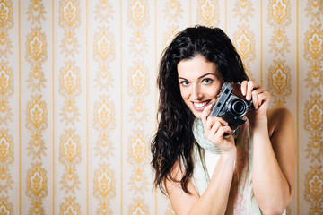 Woman with old film camera