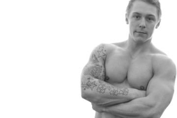 Young bodybuilder posing on white background