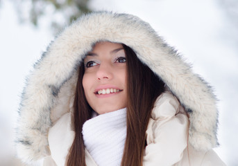 Portrait of the beautiful girl in winter
