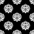 Arabesque pattern of floral motifs on black