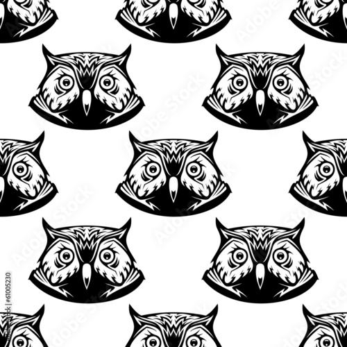 Seamless pattern of wise owl heads