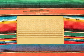 fiesta poncho rug with sombrero background with copy space