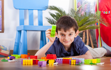 Small boy playing blocks