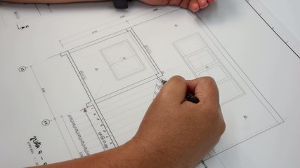 Architect designing a stairway handrail in his architect plan