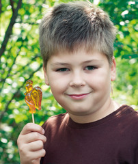 Boy with lollipop in nature