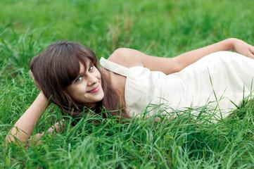 Teenager girl lying on the grass