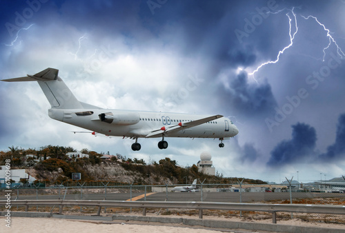 Airplane landing in the storm