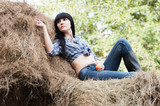 girl in a haystack with apple