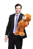 smiling businessman with teddy bear
