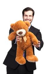 businessman giving a teddy bear