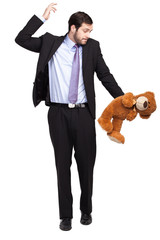 confused businessman with teddy bear