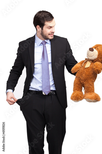 broke businessman with teddy bear
