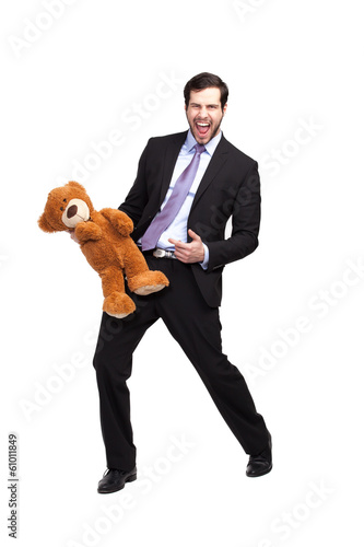 businessman with teddy bear excited