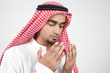 Young arab muslim praying