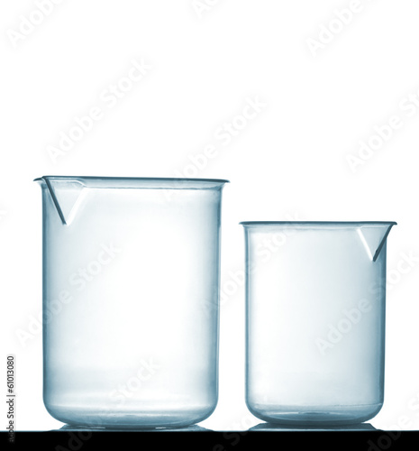 Isolated chemical plastic beakers on table