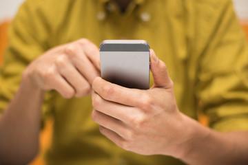 Close-up image of a man using a digital smartphone