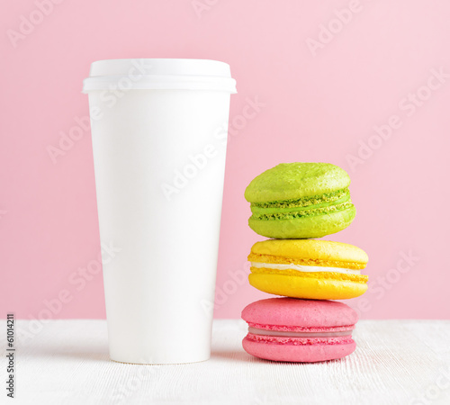 Macaron and tumbler of coffee