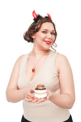 Beautiful plus size woman as devil with pastry