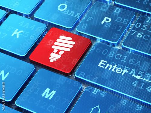 Business concept: Energy Saving Lamp on computer keyboard