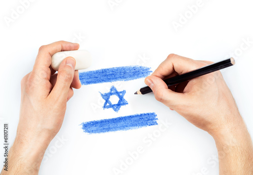 Man's hands with pencil draws flag of Israel on white