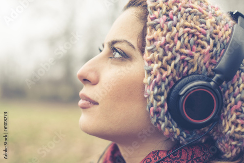 beautiful brunette woman listening to music with headphones