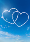 heart shaped clouds on blue sky background poster