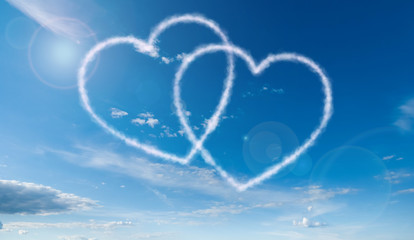 heart shaped clouds on blue sky background