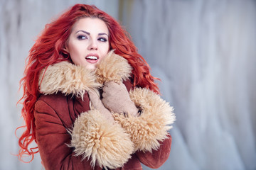 Attractive red hair woman in wintertime outdoor