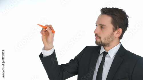 Businessman writing on a virtual interface