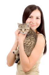 Beautiful smiling woman with a kitten in her arms
