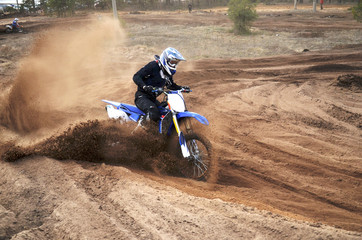 Motorcycle rider bogged down in loose sand cornering