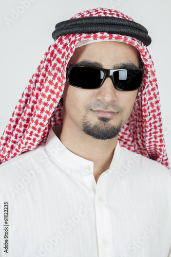 Young arab portrait wearing sun glasses