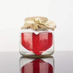 Glass jar with heart inside