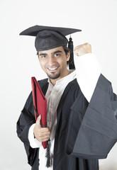 Asian student graduate raising his hand