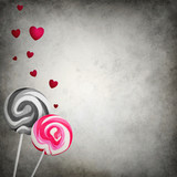 Unmatched lollipops with floating hearts on grunge background