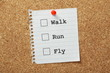 Walk, Run or Fly Tick Boxes on a cork notice board