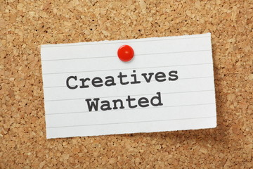 Creatives Wanted memo on a cork notice board