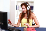 Busy female in home office, with computer headset