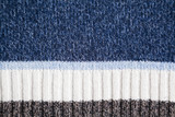blue woolen fabric with stripes and selective focus