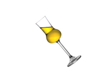 A tilted full grappa glass isolated on white