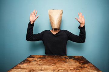scared man with bag over head