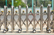 Iron sliding fence with wheel.